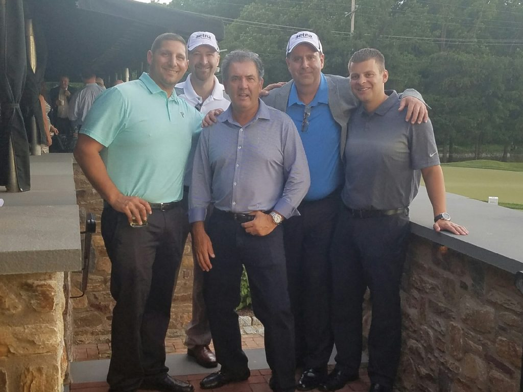 Greg Gudis, Tim McEvoy, Joe Bachmeier, and James Coon grab a picture with David Frost