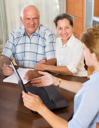 an insurance agent with elderly couple