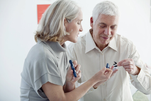elderly man checks blood sugar