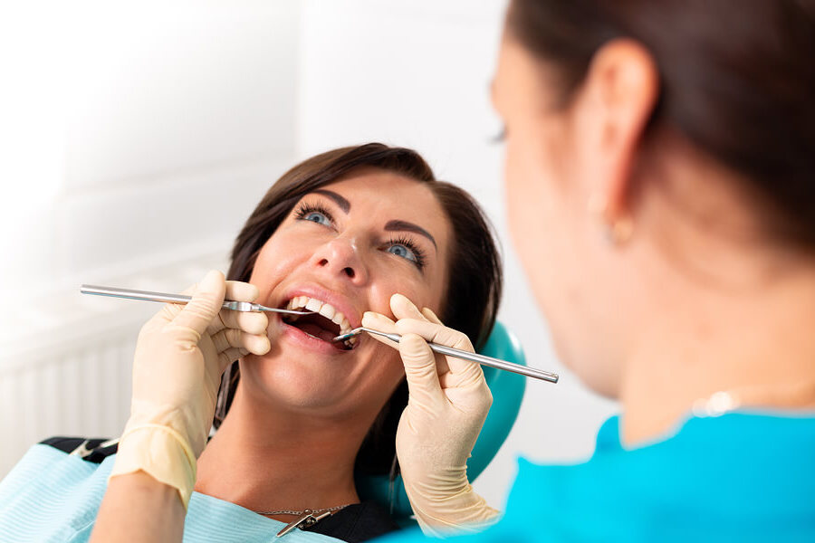 dentist inspecting braces