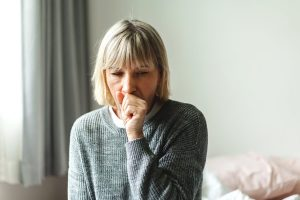 senior coughing from flu